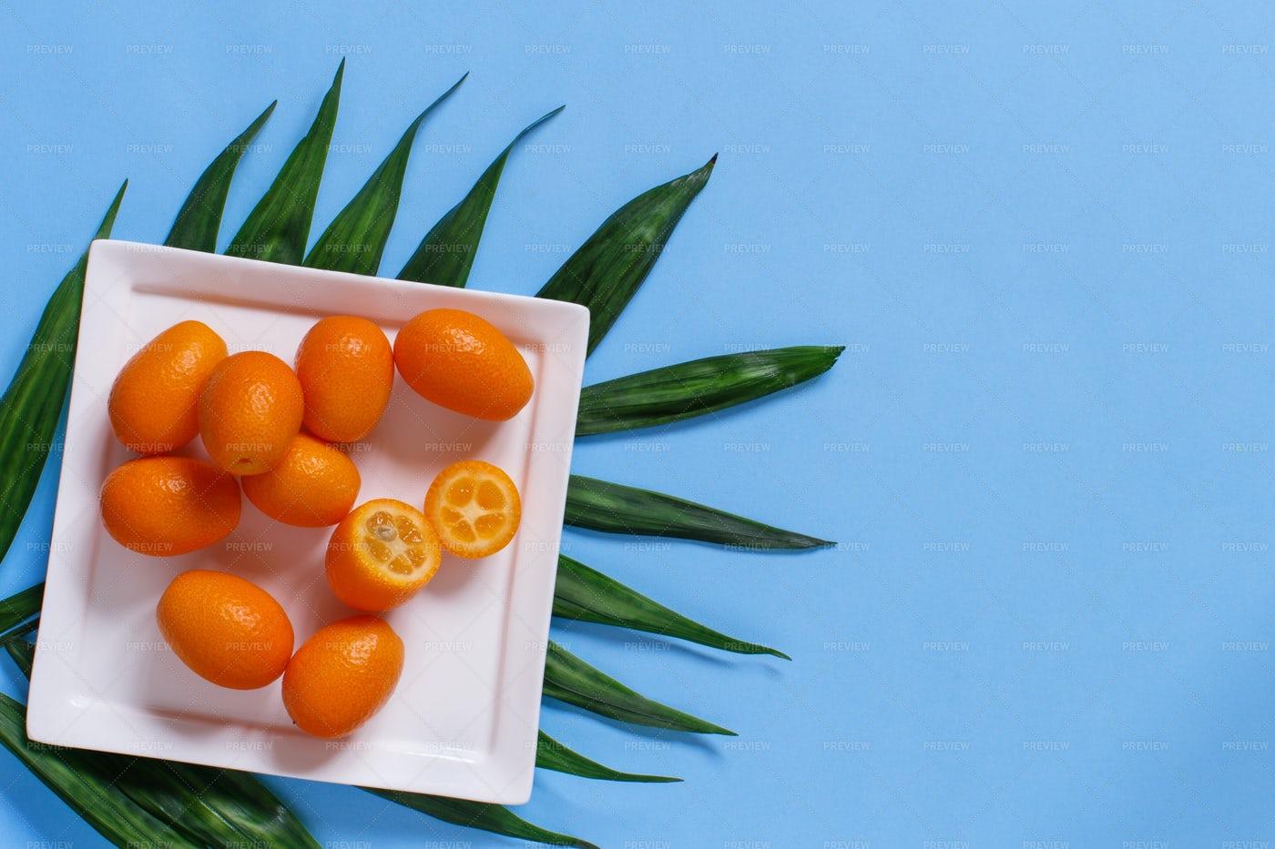 Kumquat Fruits On Blue: Stock Photos