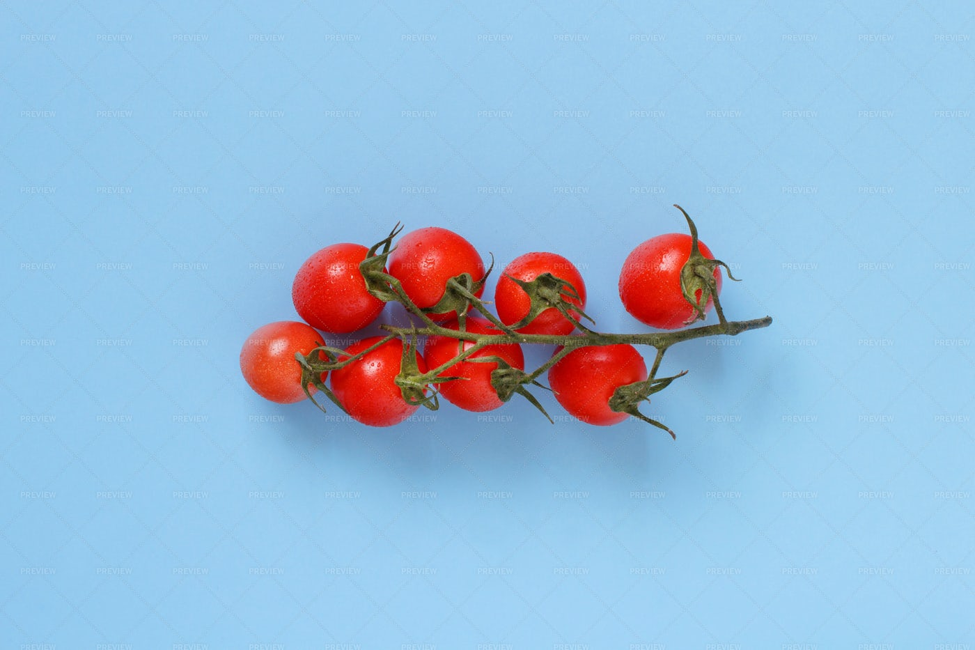 Cherry Tomatoes On  Blue: Stock Photos