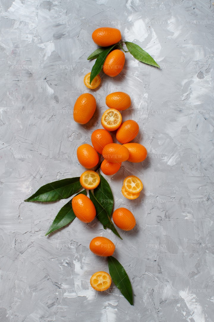 Kumquat Fruits On Gray: Stock Photos