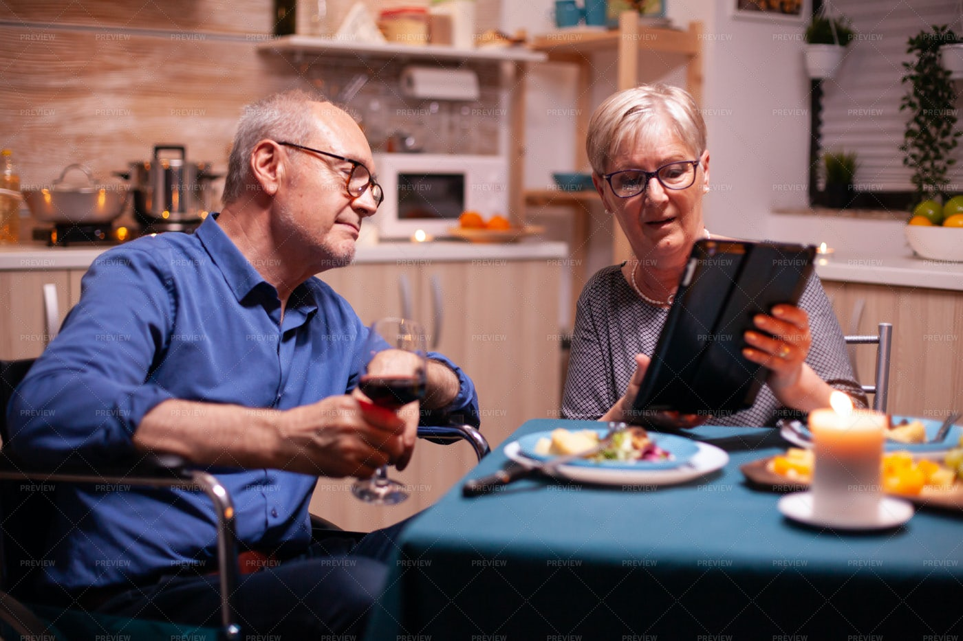 Using A Tablet At Dinner: Stock Photos