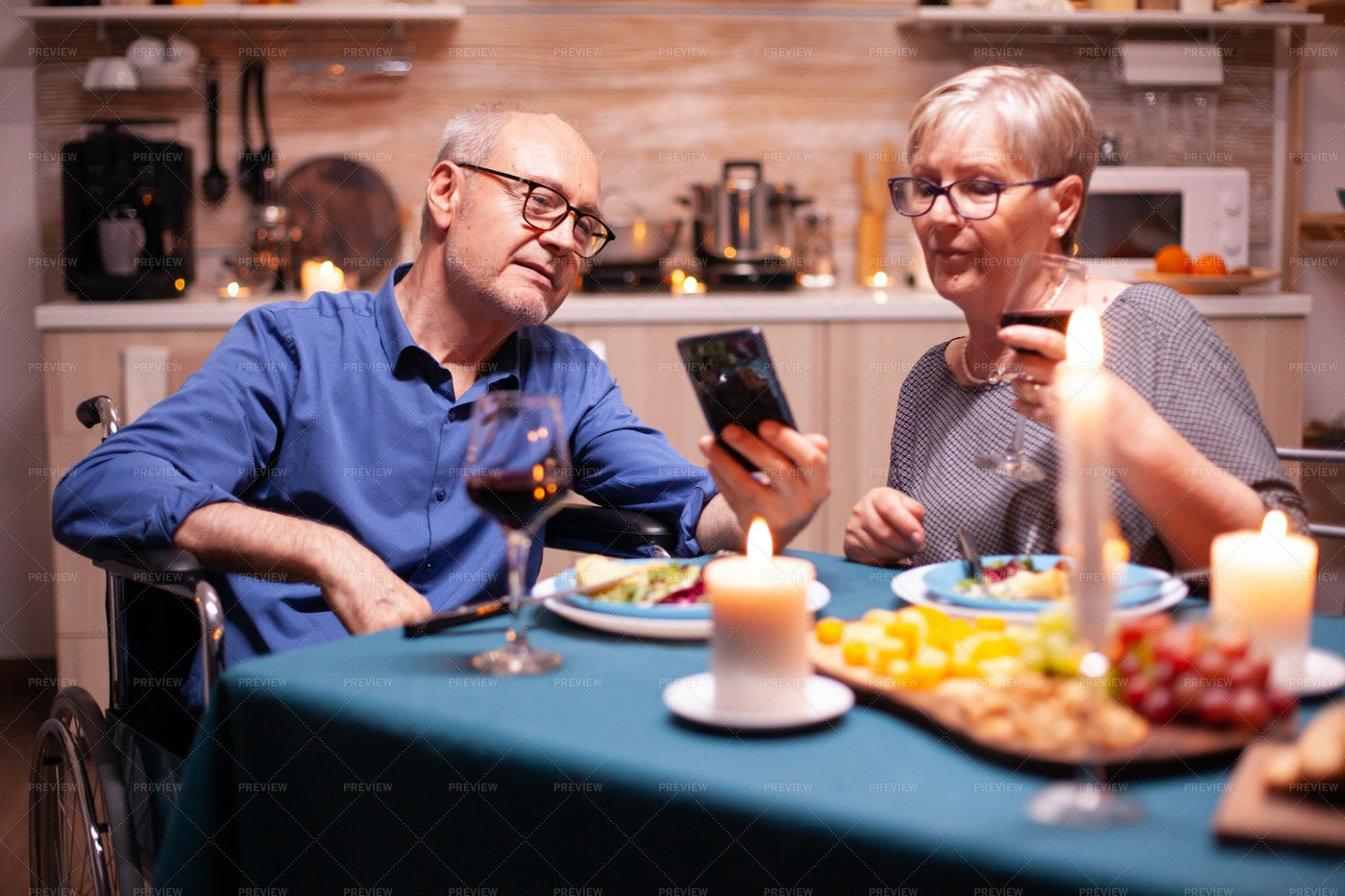 Holding A Phone During Dinner: Stock Photos