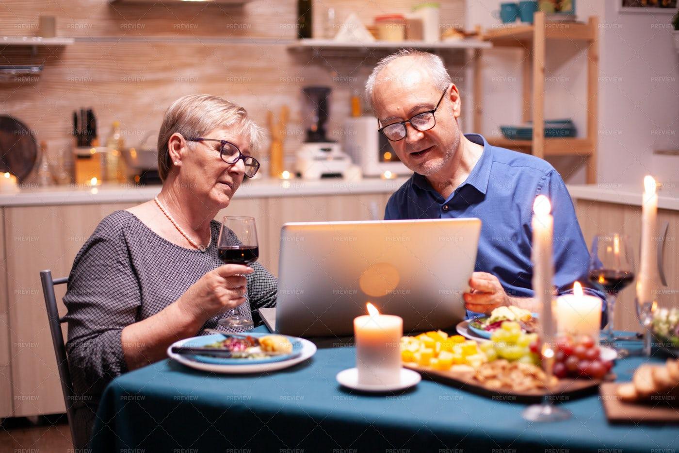 Using A Laptop At Dinner: Stock Photos