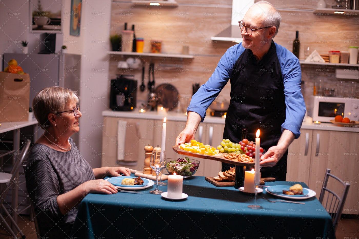 Senior Man Serving Romantic Dinner: Stock Photos
