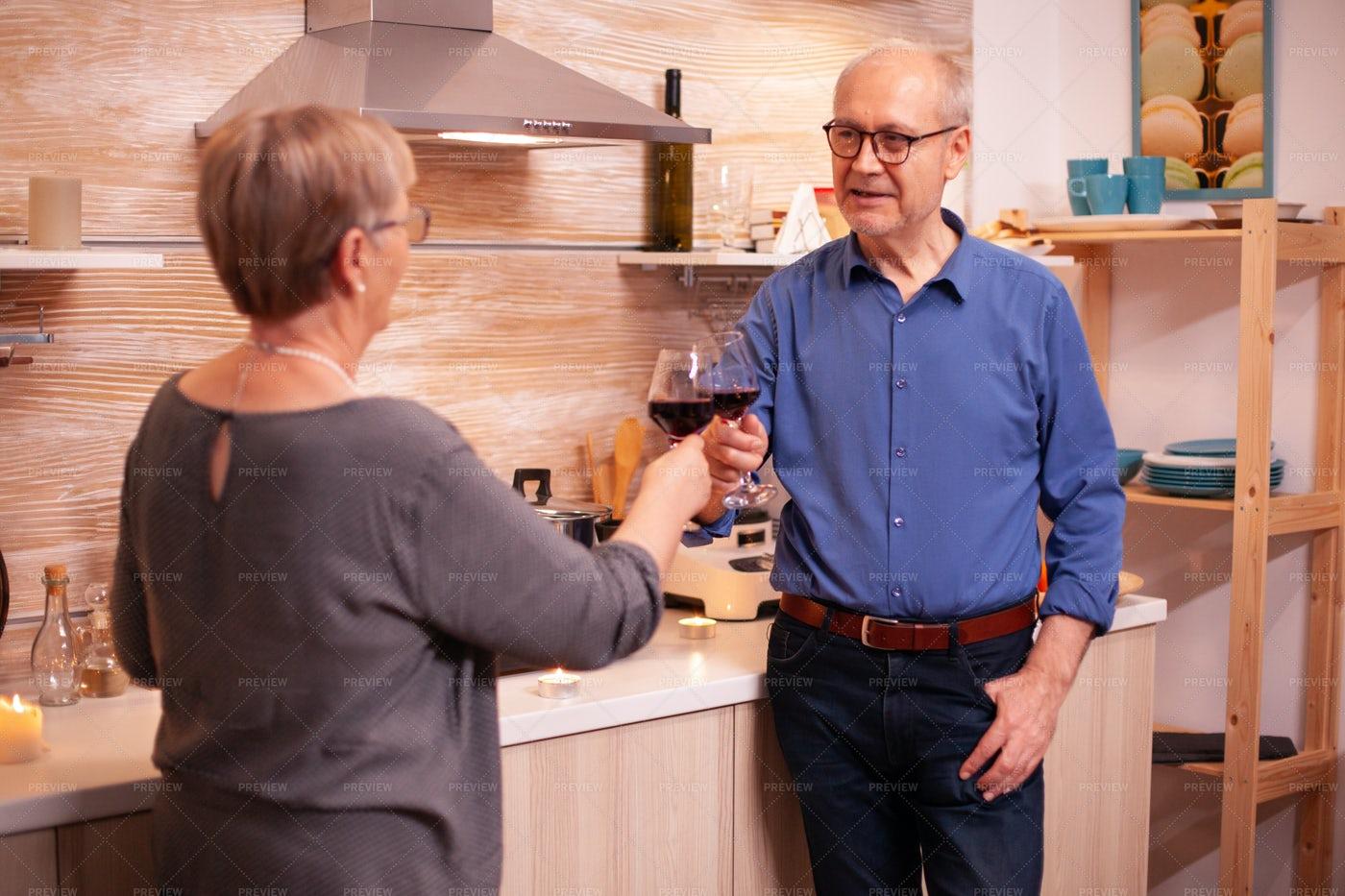 Senior Couple Shares A Toast: Stock Photos