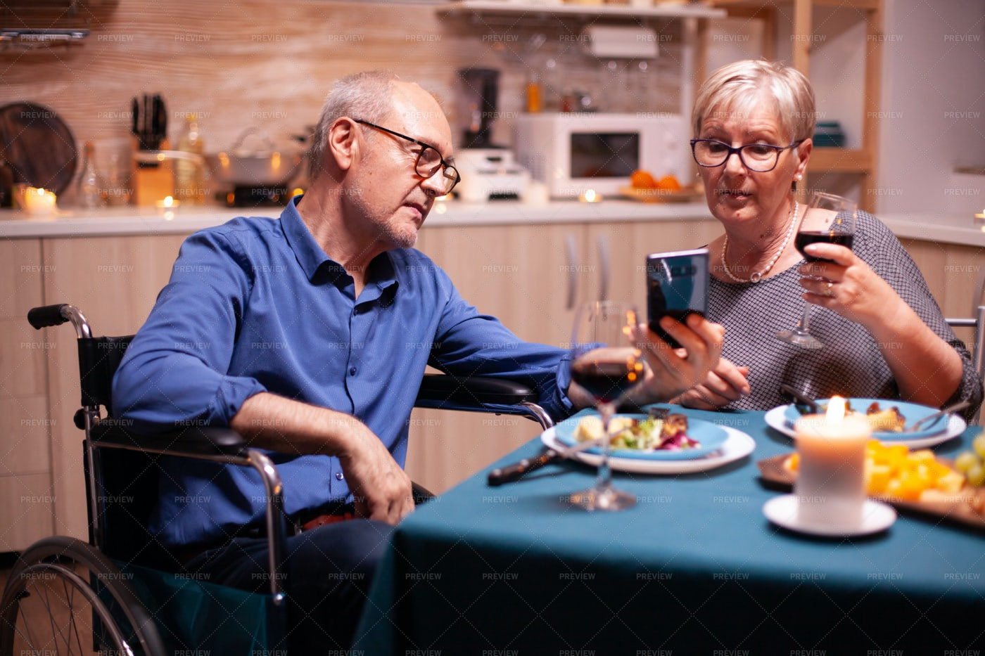 Showing His Smartphone At Dinner: Stock Photos