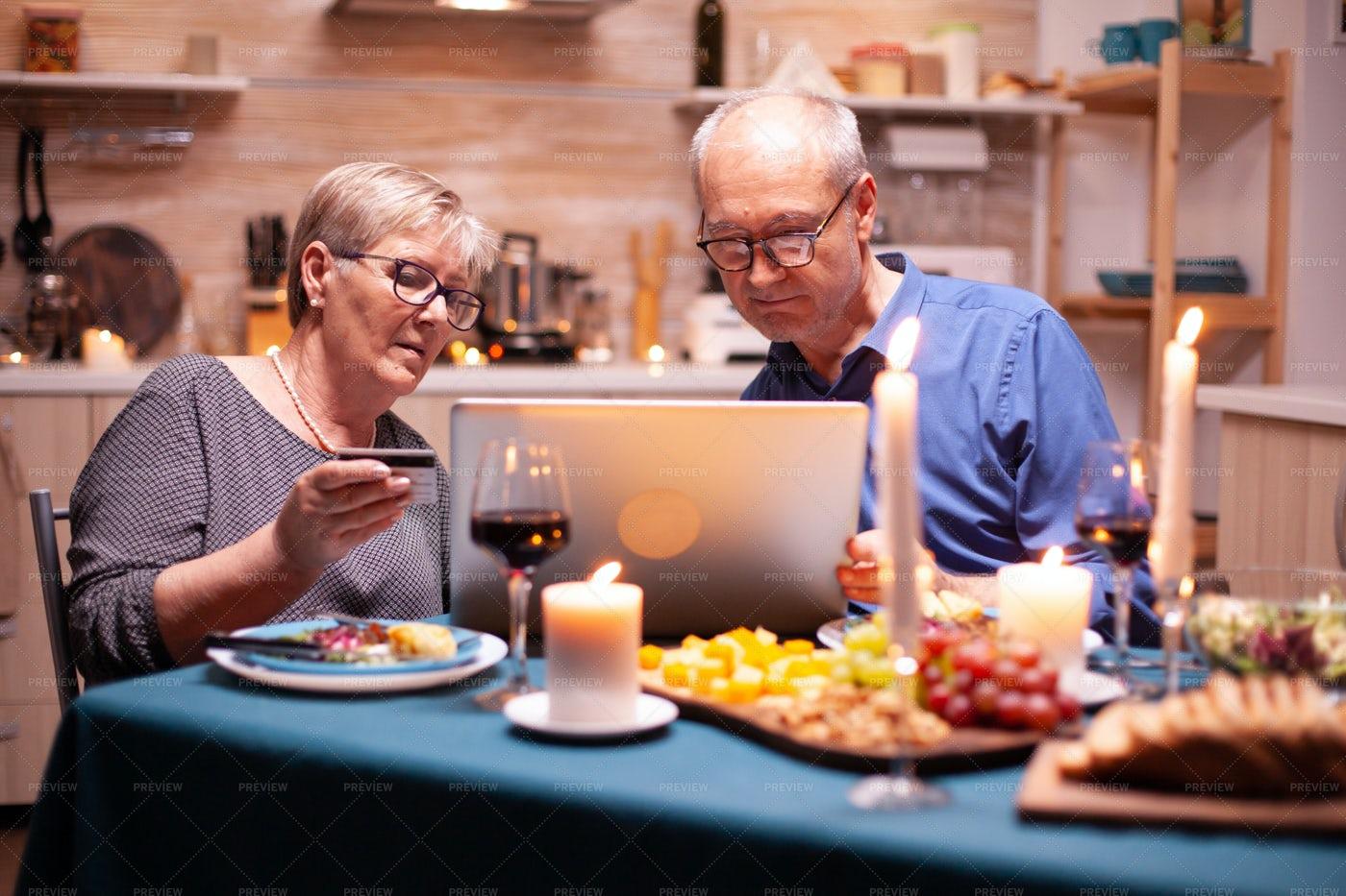 Elderly Couple Using Credit Card: Stock Photos