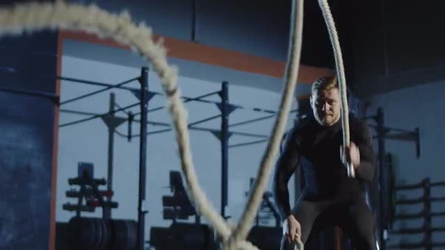Athlete Playing With Battle Ropes: Stock Video