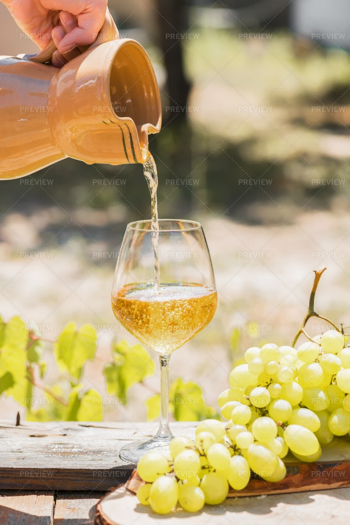 Pouring Amber Wine: Stock Photos