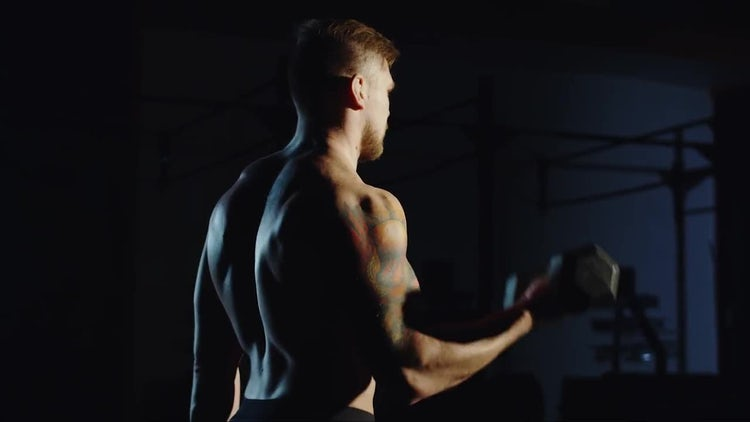 Male Bodybuilder Lifting Heavy Dumbbells: Stock Video