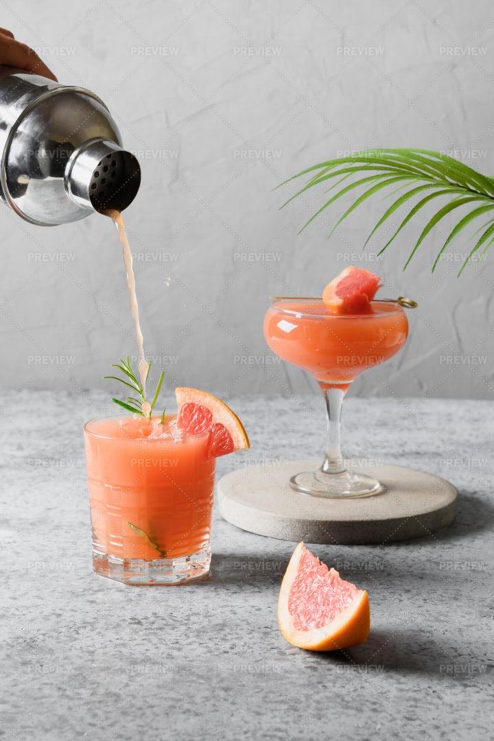 Pouring Grapefruit Cocktails: Stock Photos