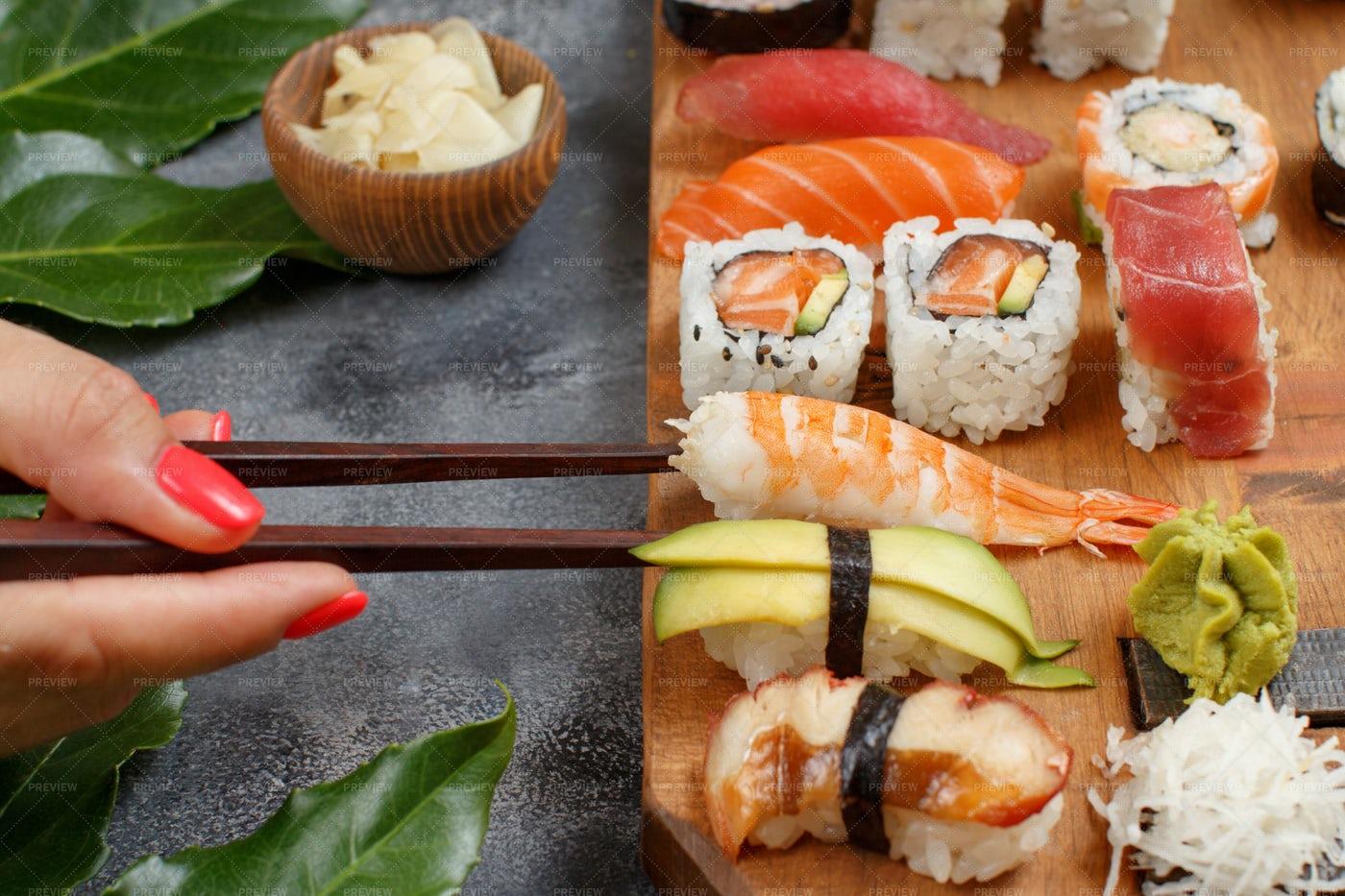 Hand Taking Sushi Rolls: Stock Photos