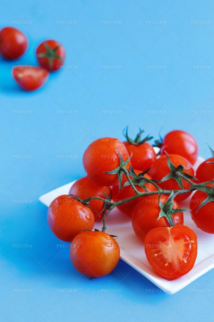 Cherry Tomatoes On Blue: Stock Photos