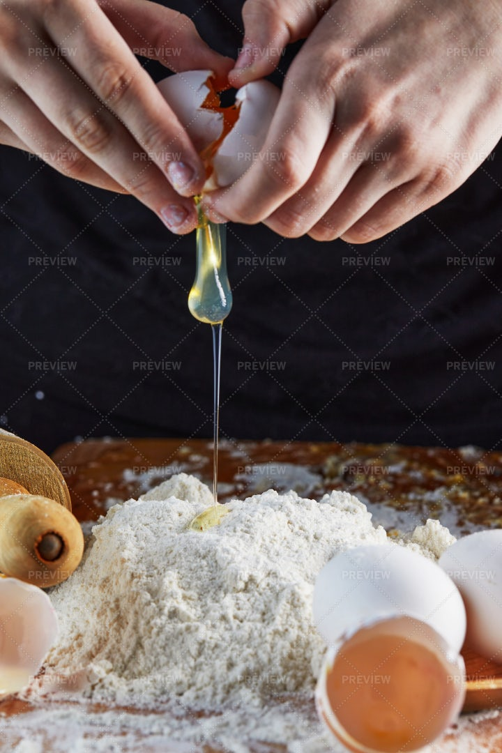 Adding Egg To Dough: Stock Photos