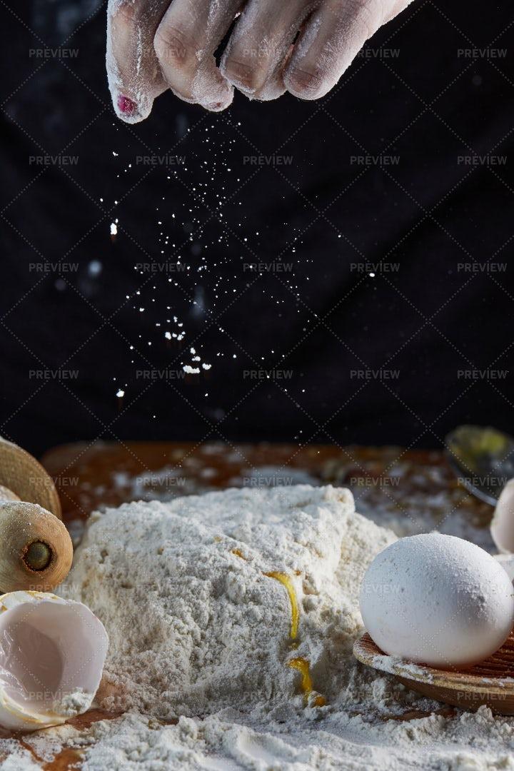 Sprinkling Flour Into Dough: Stock Photos