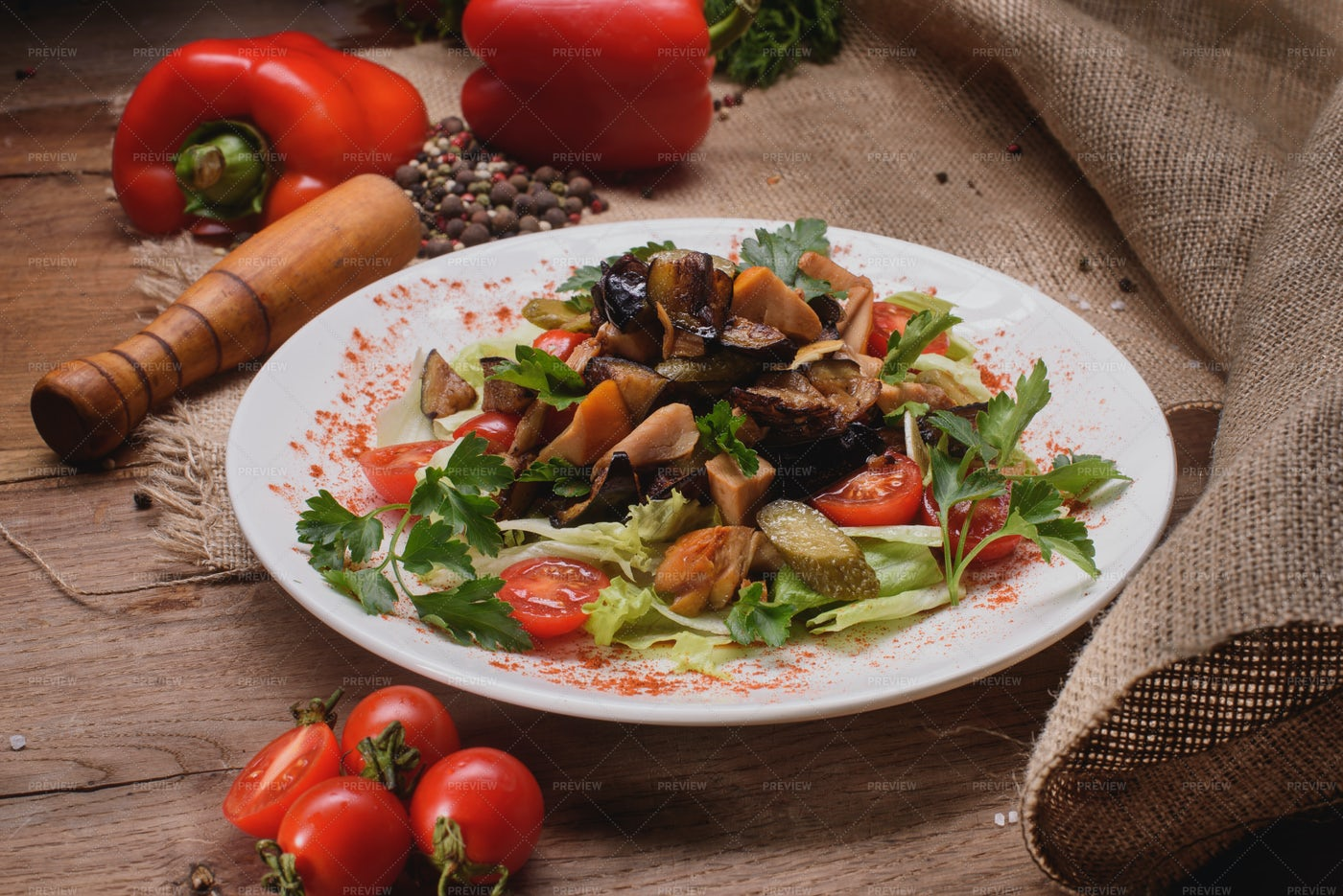 Warm Eggplant Salad On Rustic Table: Stock Photos