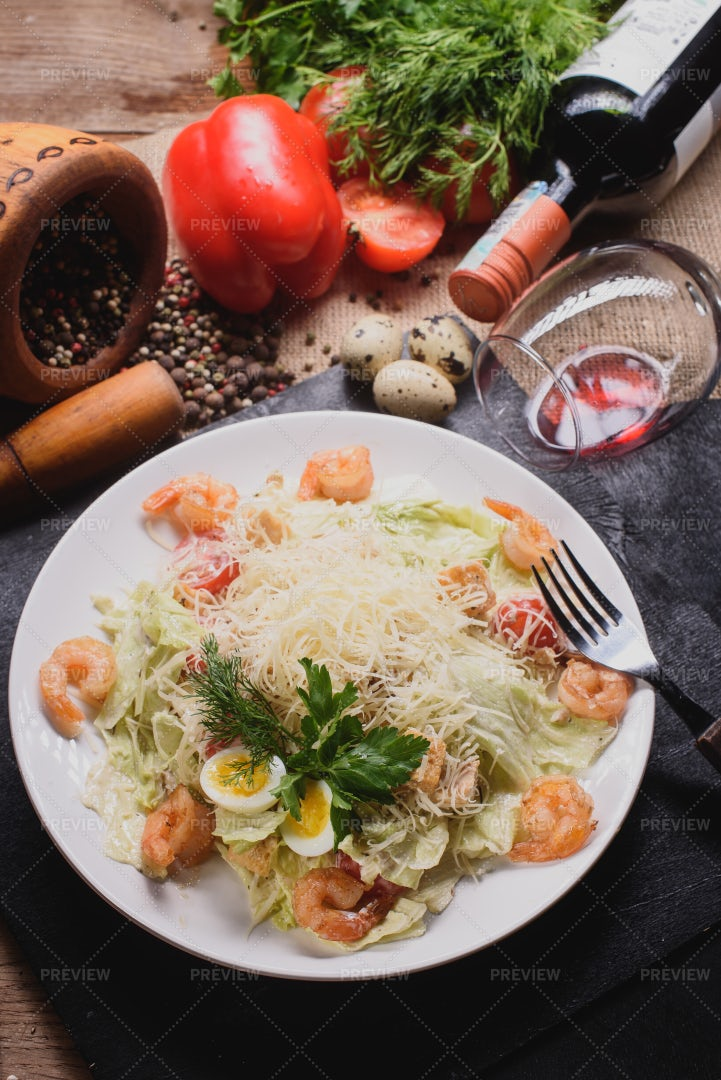 Shrimp Caesar Salad With Red Wine: Stock Photos