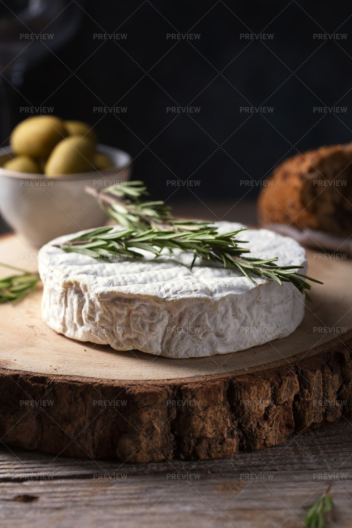 Camembert Cheese Rosemary And Olives: Stock Photos