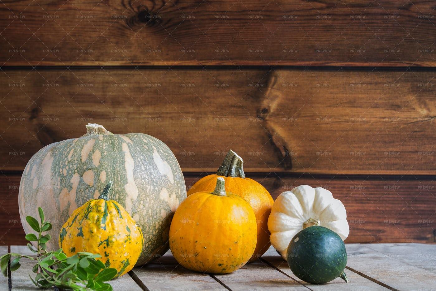 Pumpkins Against Wood: Stock Photos