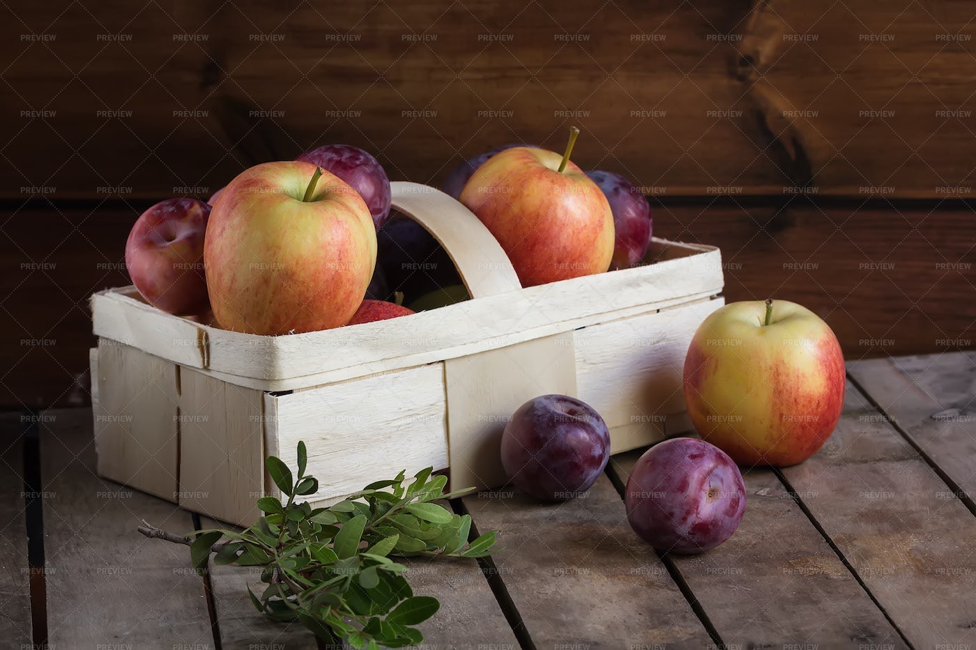 Apples And Plums In A Basket: Stock Photos
