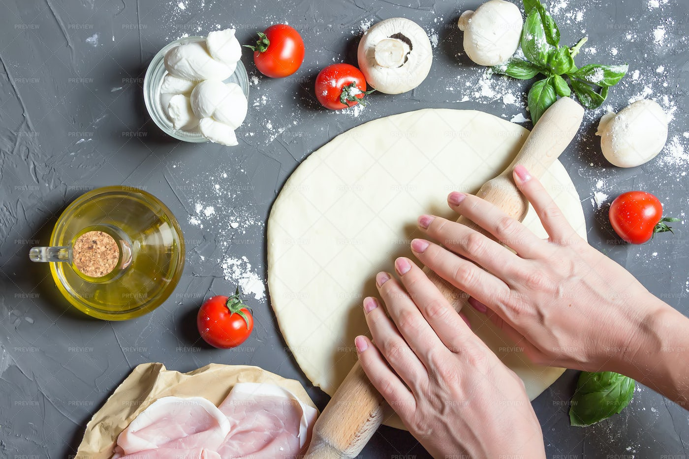 Hands Rolling Out Pizza Dough: Stock Photos