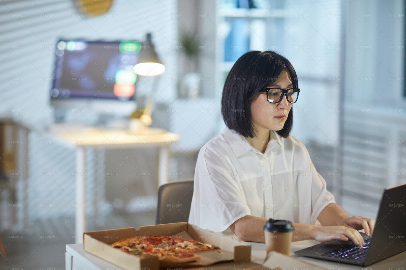 Businesswoman Working During Lunch: Stock Photos
