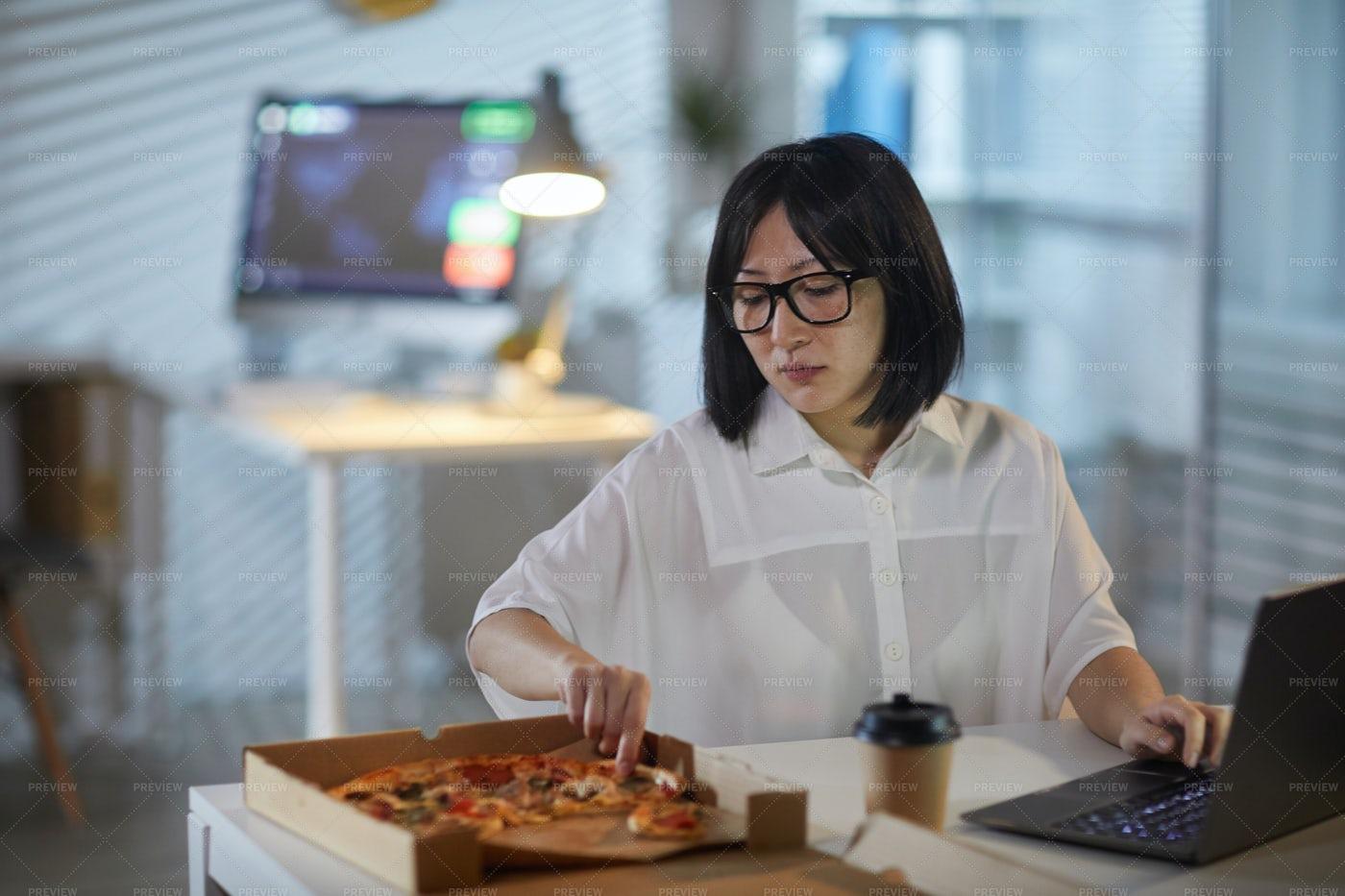 Businesswoman Eating During Work: Stock Photos