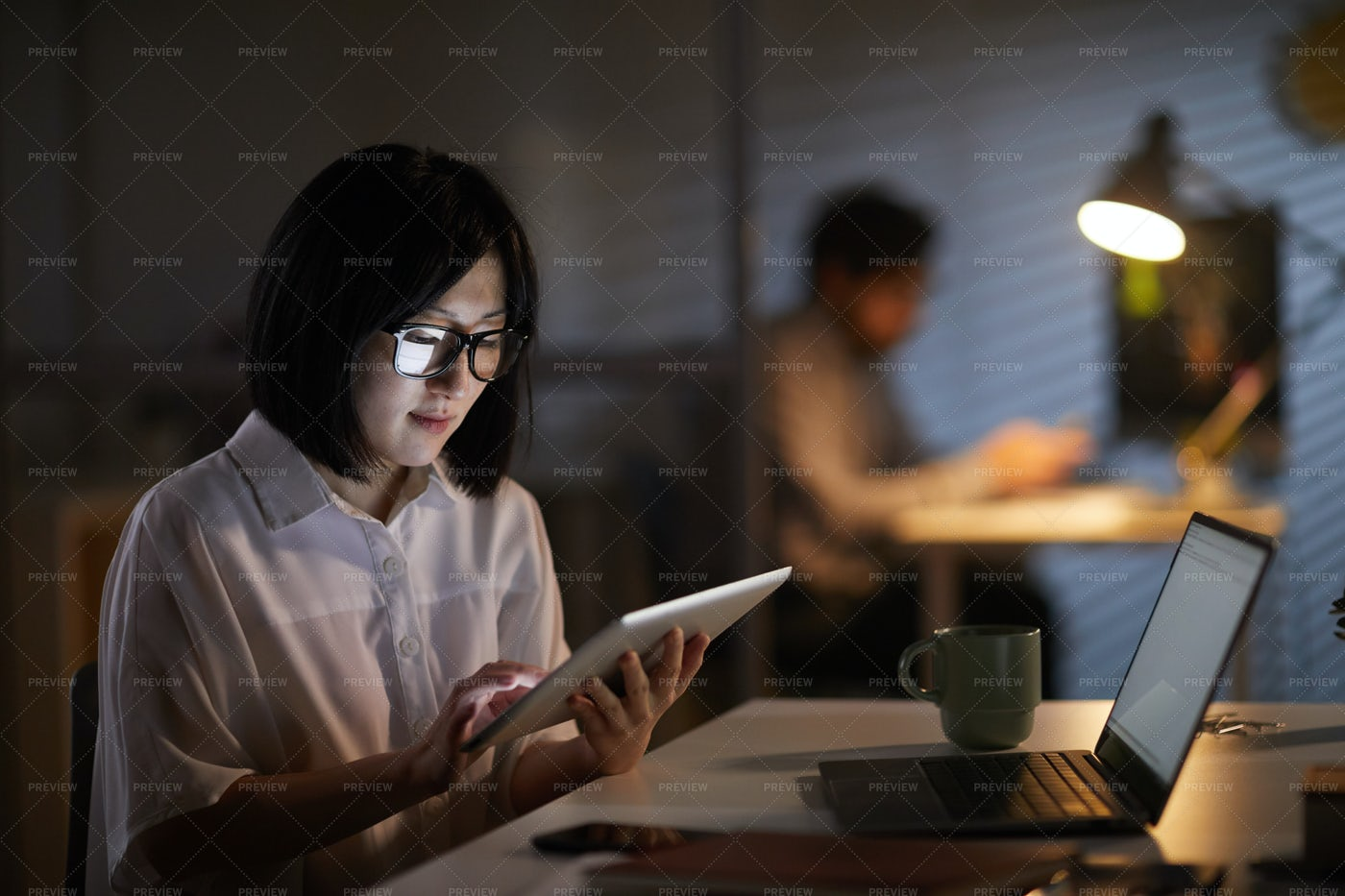 Businesswoman Working On A Tablet: Stock Photos