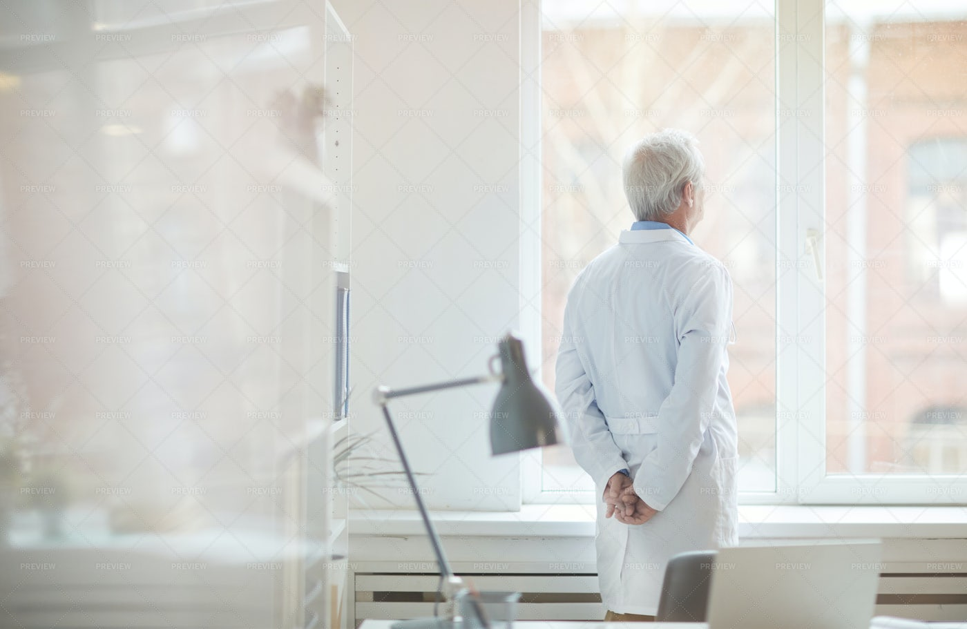 Doctor At The Window: Stock Photos