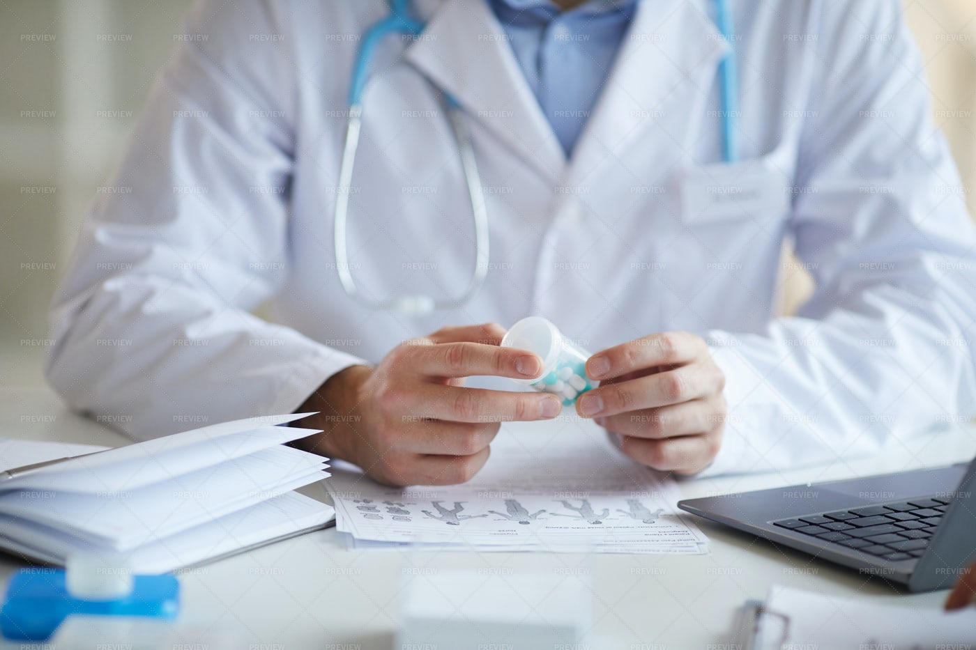 Doctor With Pills At Clinic: Stock Photos