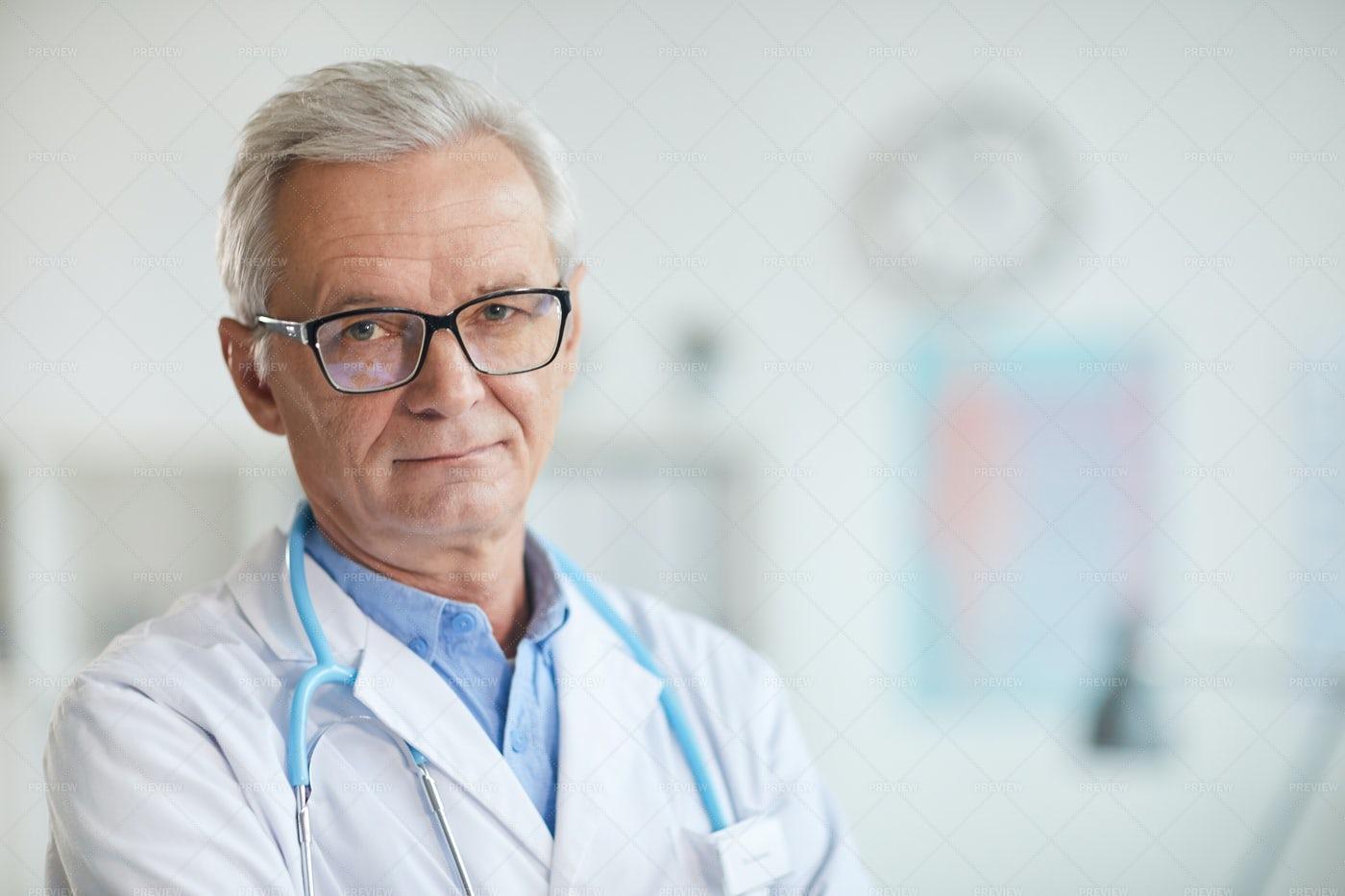 Experienced Senior Doctor Portrait: Stock Photos