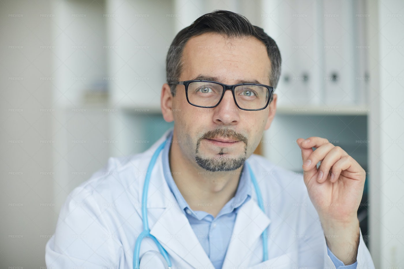 Doctor In His Office Close-Up: Stock Photos