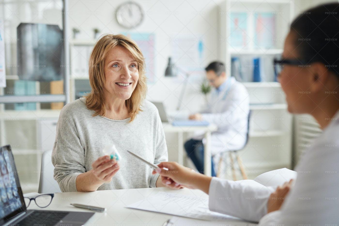 Female Patient Discussing Prescription: Stock Photos