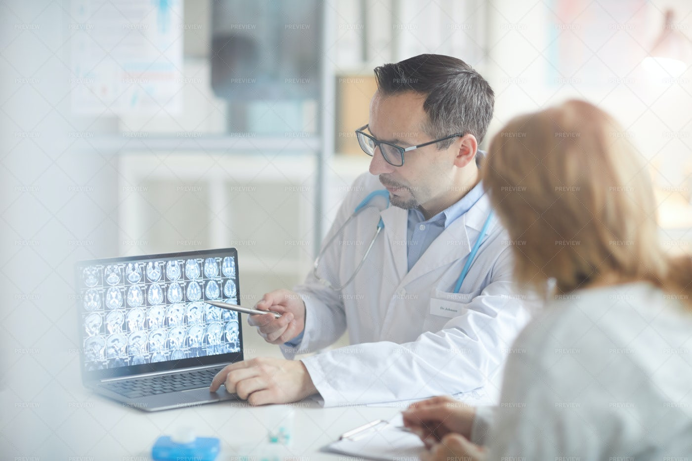 Doctor Showing X-Rays To Patient: Stock Photos