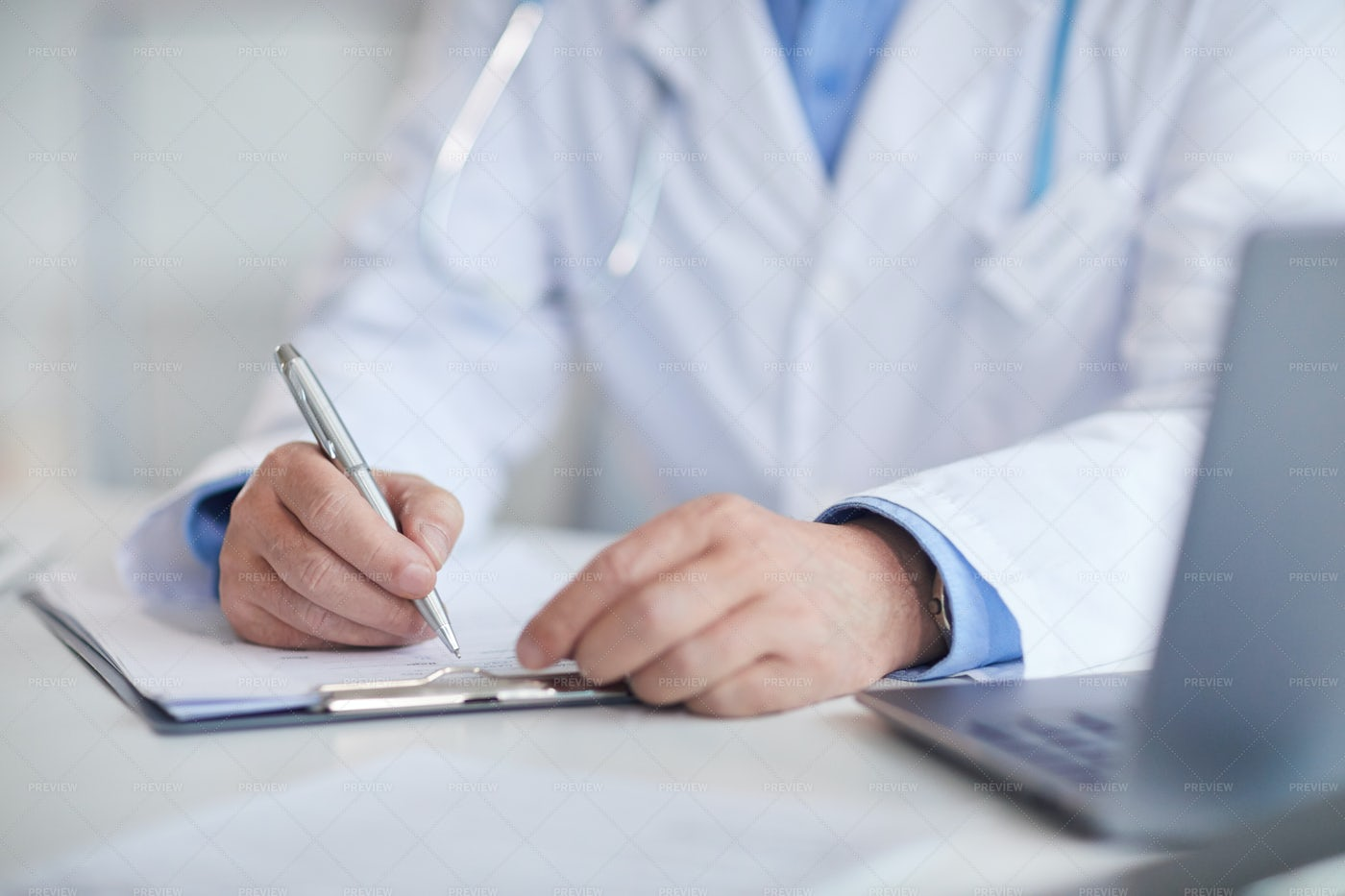 Doctor Writing In Patient's Chart: Stock Photos