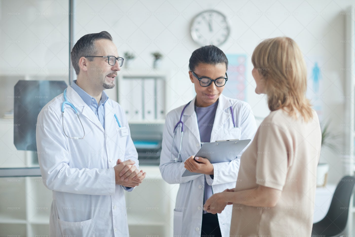 Doctor And Nurse Speak With Patient: Stock Photos