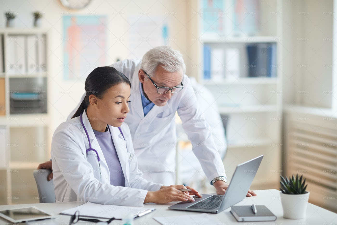 Two Doctors Working Together: Stock Photos