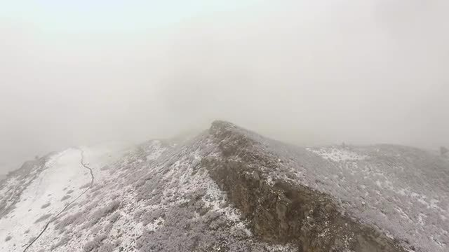 Aerial View Of Snowy Cliff : Stock Video
