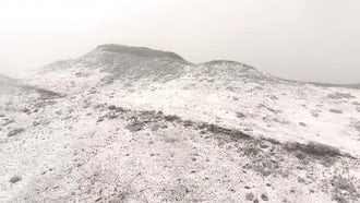 Aerial View Of Snowy Mountain: Stock Footage