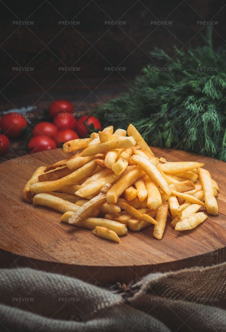 French Fries Against Wood: Stock Photos