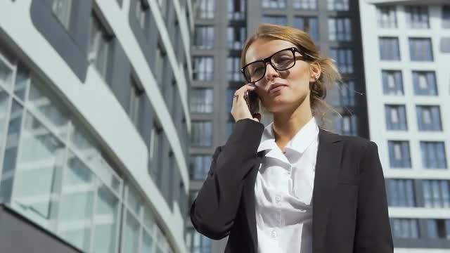 Attractive Businesswoman Answering Phone Call   : Stock Video