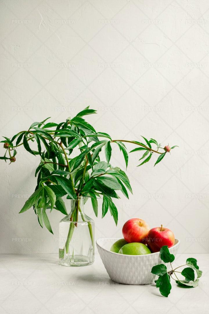 Apples Beside A Plant: Stock Photos