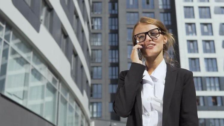 Talking On Phone While Walking: Stock Video