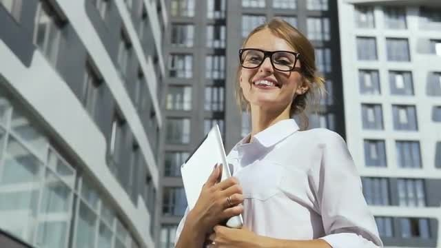 Smiling Businesswoman With A Tablet : Stock Video