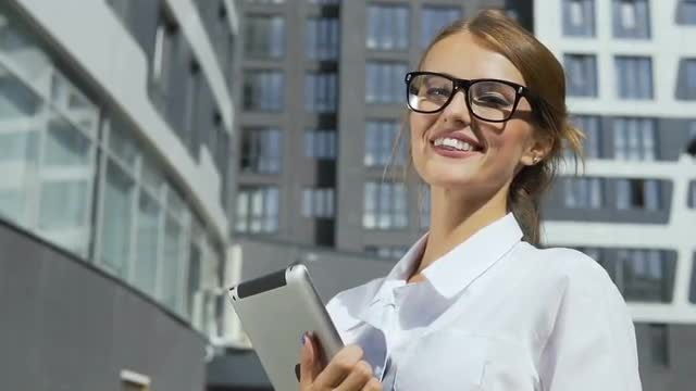 Gorgeous Businesswoman Holding Tablet PC: Stock Video