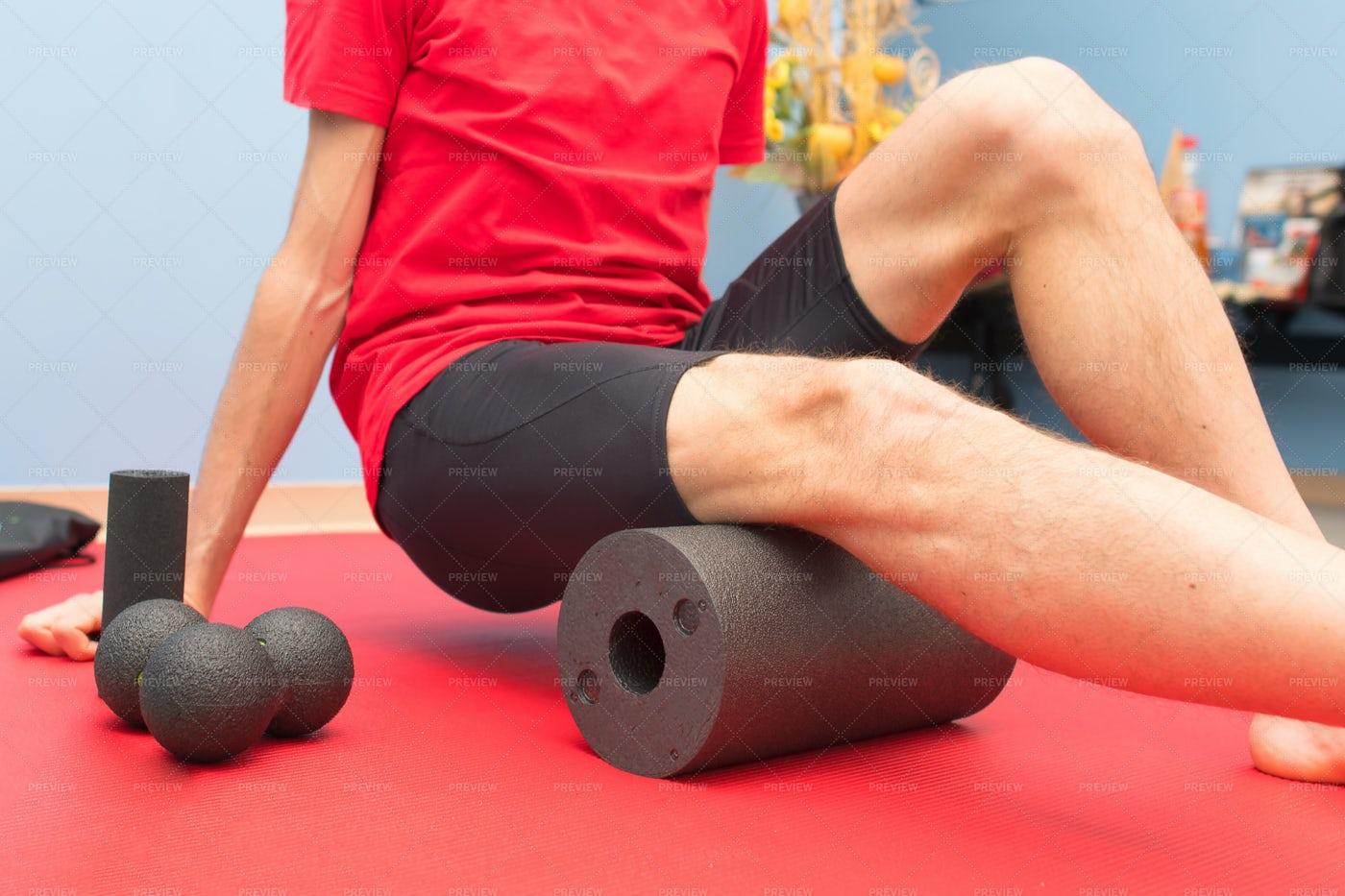 Foam Roller Thigh Treatment: Stock Photos