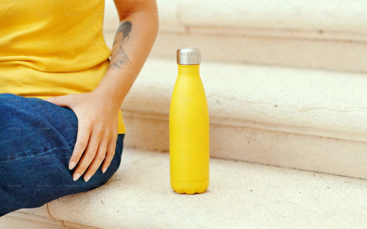 Woman Sitting With A Yellow Bottle: Stock Photos