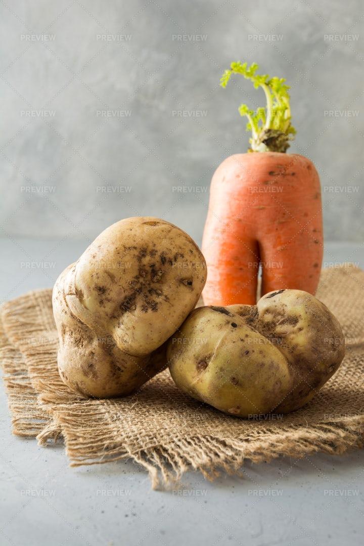 Ugly Carrot And Potatoes: Stock Photos