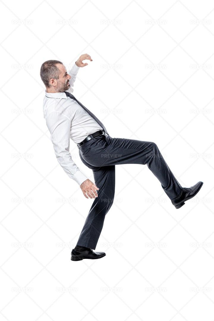 Businessman Losing His Balance: Stock Photos