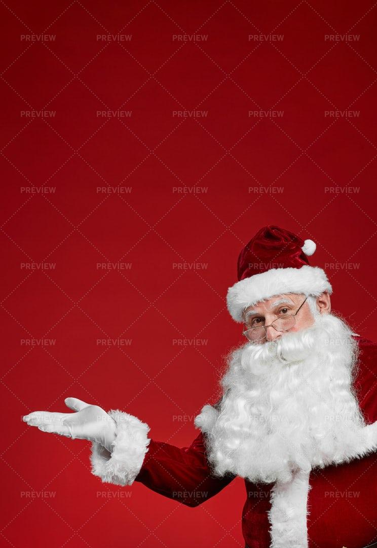 Santa Claus Advertising Something: Stock Photos
