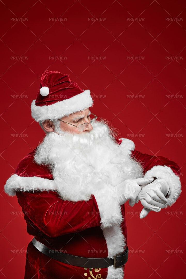 Santa Checking The Time: Stock Photos